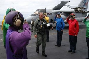 George_W_Bush_on_the_deck_of_the_USS_Abraham_Lincoln