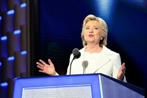 Image by Ali Shaker via http://m.voanews.com/a/democrats-celebrate-republicans-criticize-clinton-speech/3439780.html